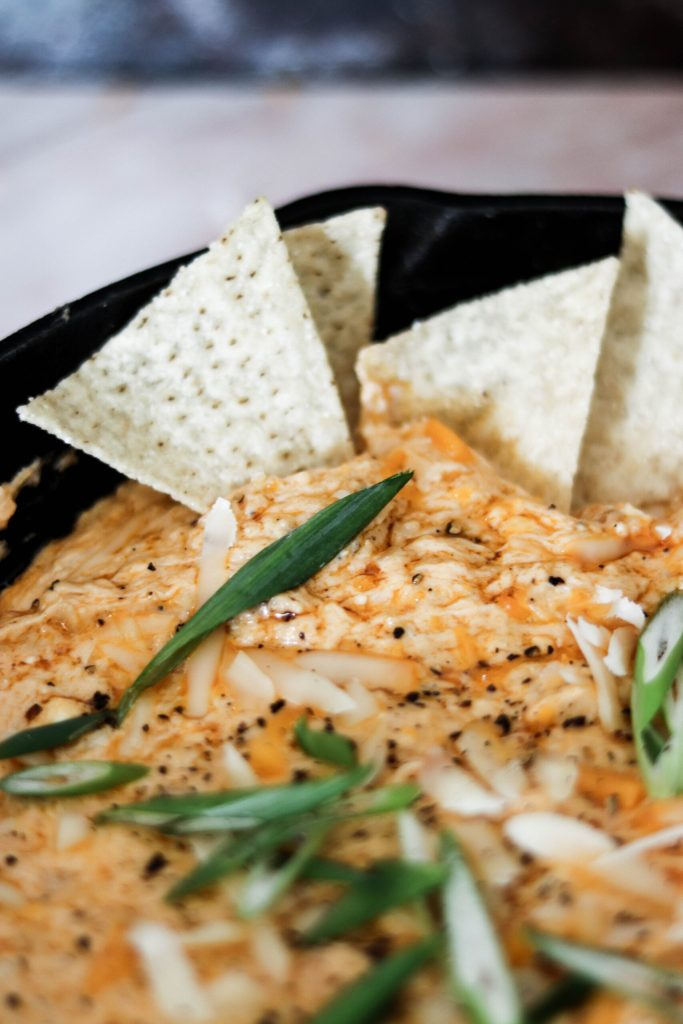 tortilla chips stuck in buffalo crab dip