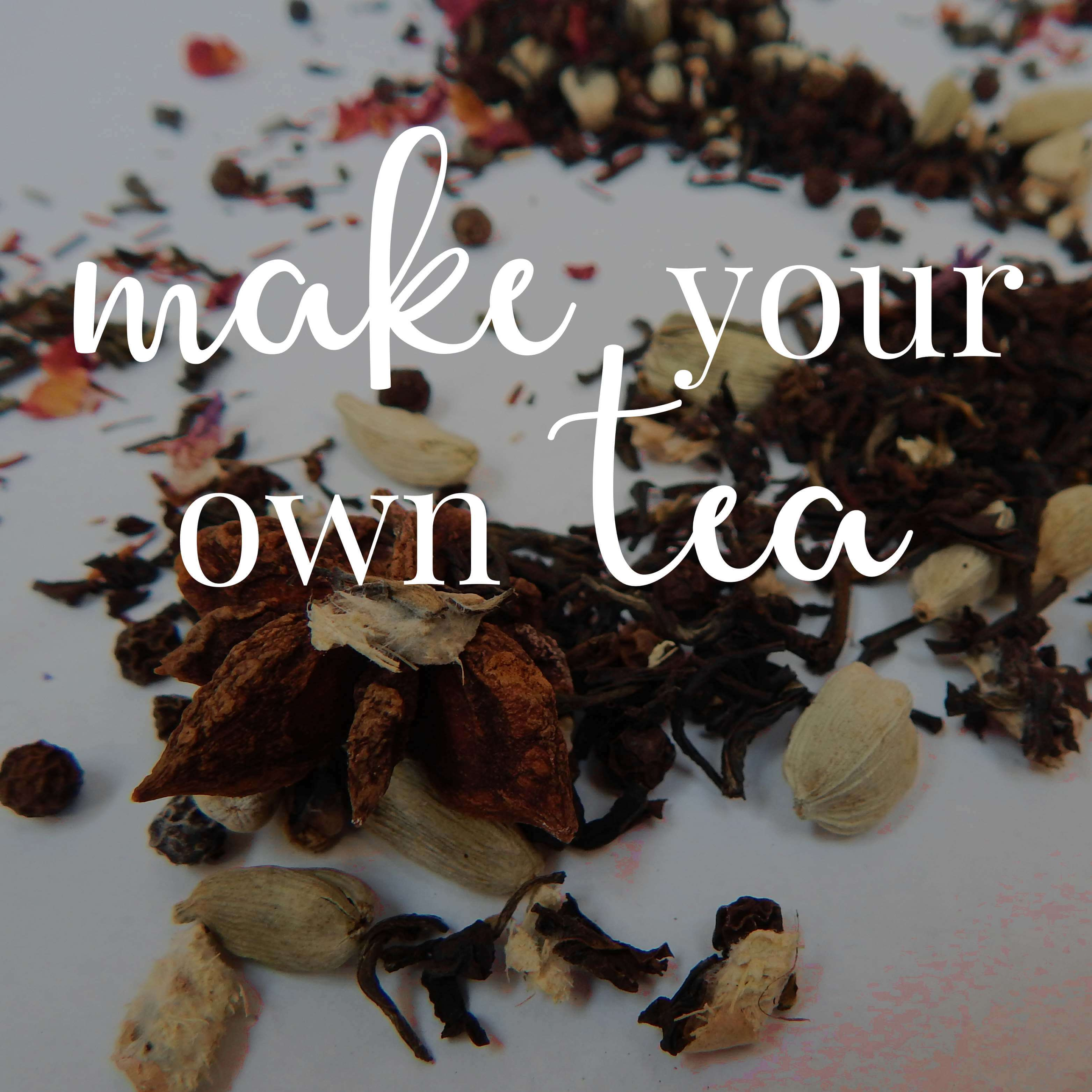 "Tea leaves and spices scattered on a white background. Text overlaid reads ""Make your own tea."""