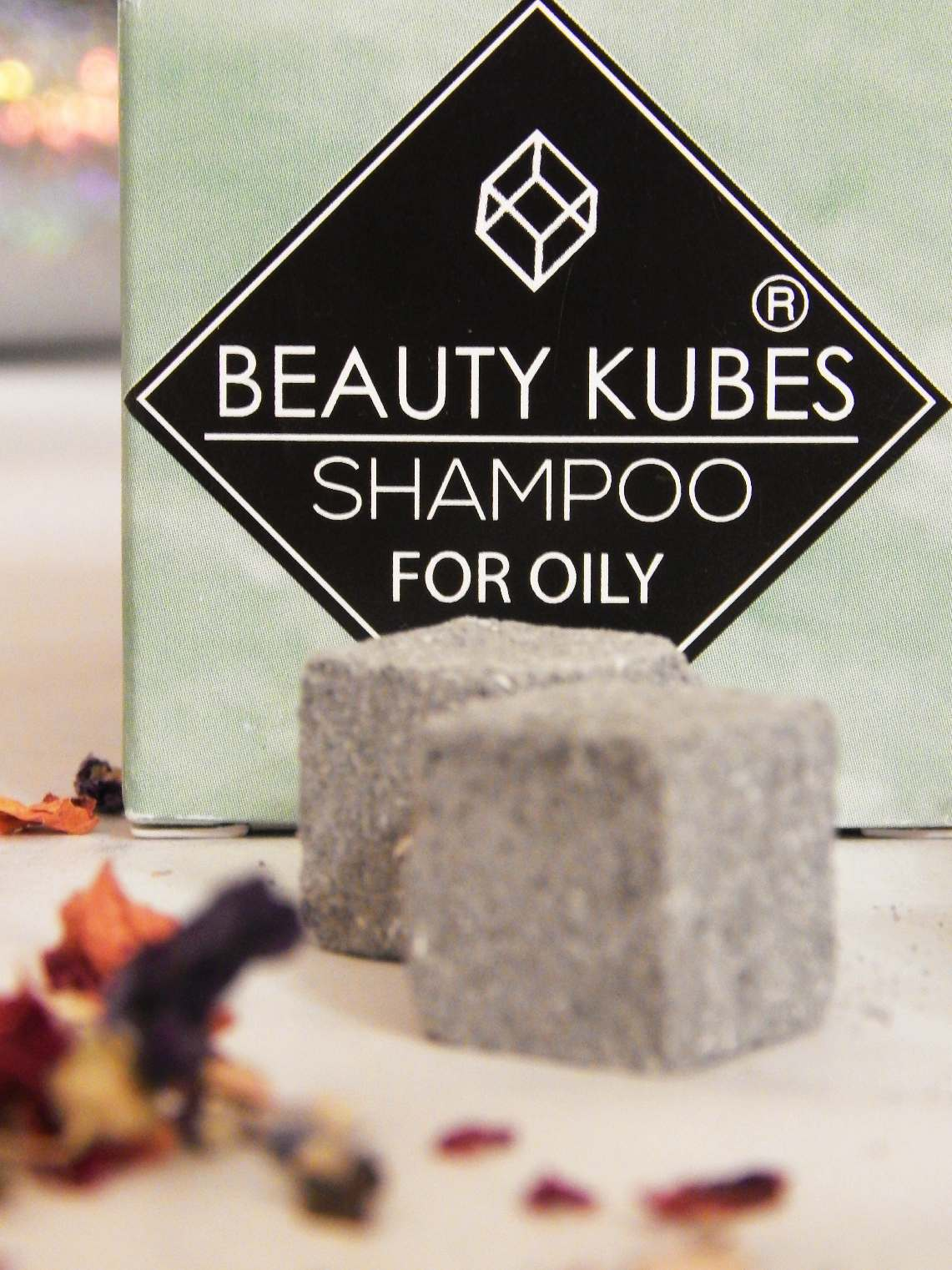 Box of Beauty Kubes with loose cubes and dried flowers in the foreground