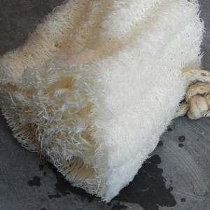 Wet loofah washing up sponge on slate
