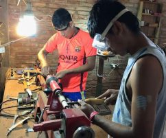 The boys working in the fully equipped carpentry shop.