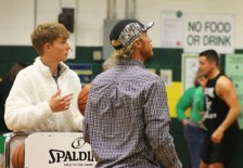 Colton Taylor helping Shepard King during the three point shootout