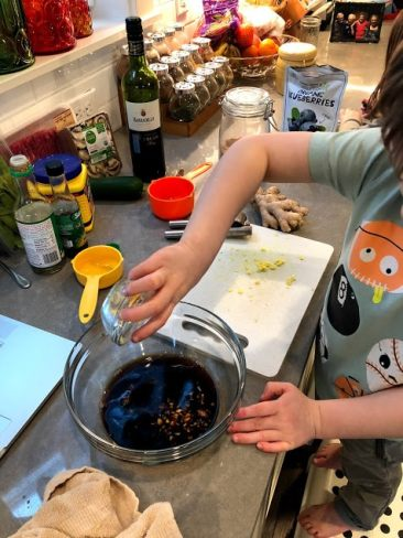 Child making stir fry sauce