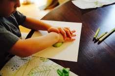 Child making bok choy rose