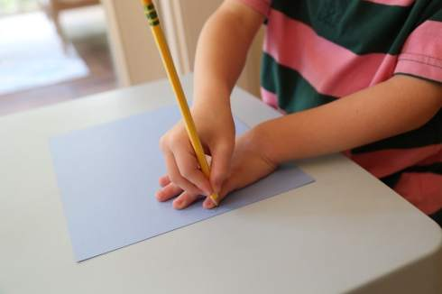 Child tracing handprints