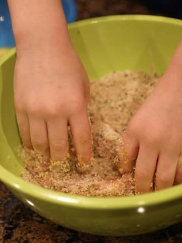 Child mixing meat together