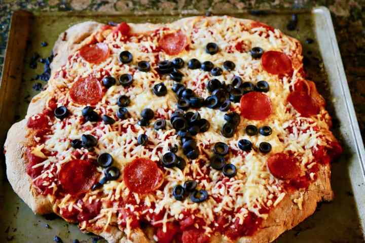 cooked pizza on pan