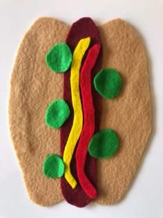 Felt hot dog with pickles on side