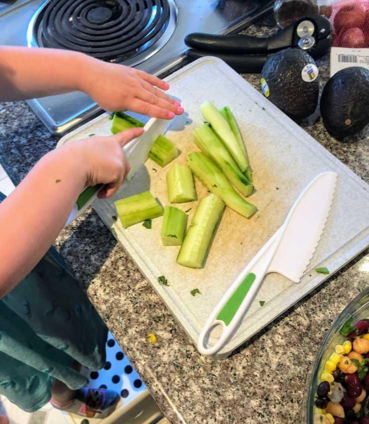 Child chops cucumber