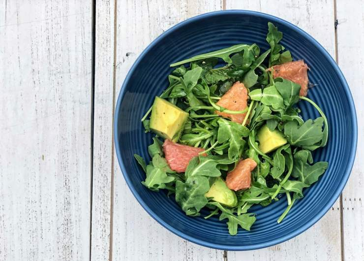 Grapefruit, Avocado & Arugula Salad on white table