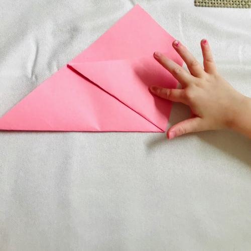 folding first half of paper triangle