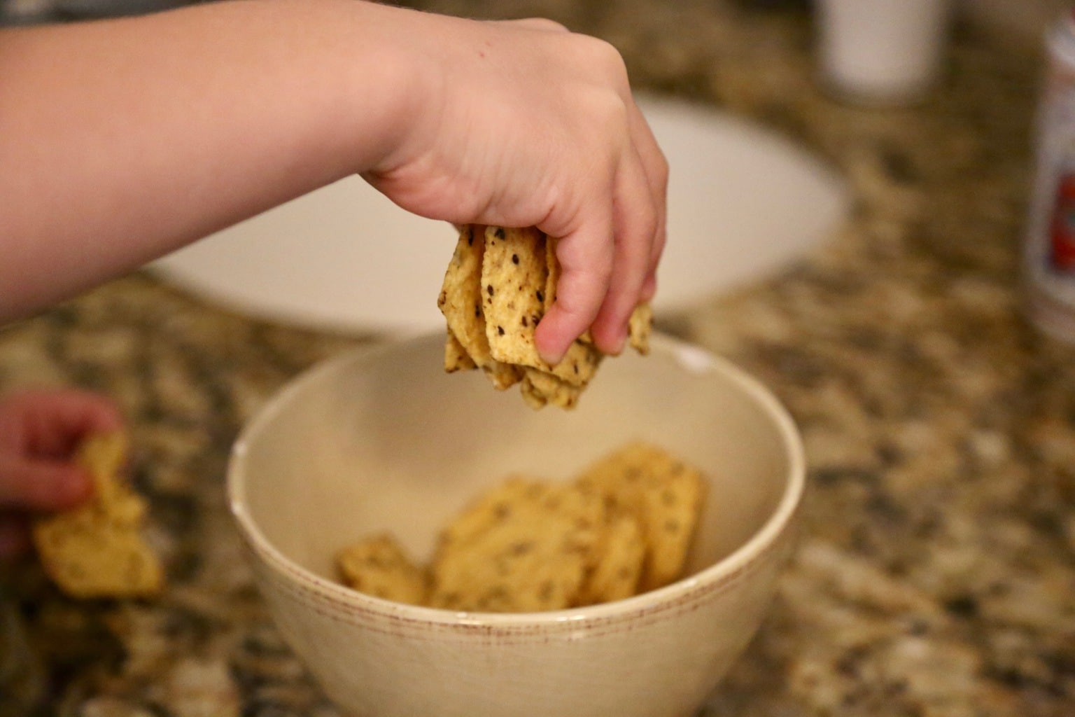 CHILD CRUSHING CHIPS WITH HANDS