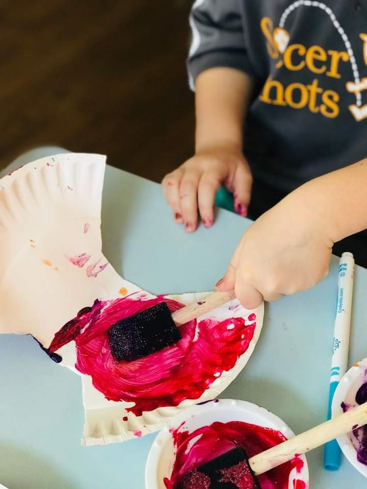 child painting scallop shell