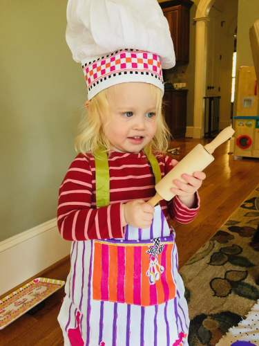 child dressed as chef