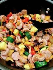 stirring autumn pasta veggies and sausage