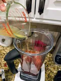 adding broth to soup