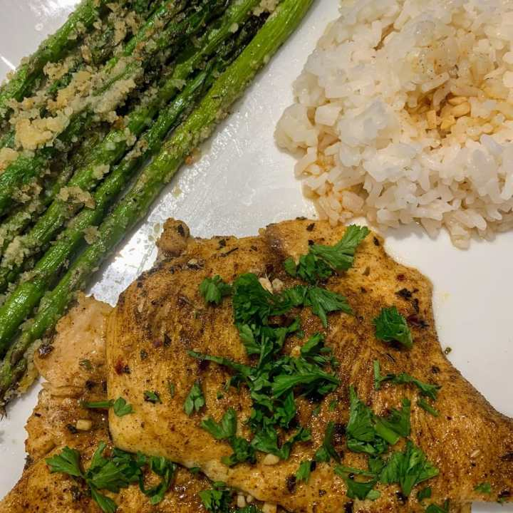 Lemon Chicken with Roasted Parmesan Asparagus on plate