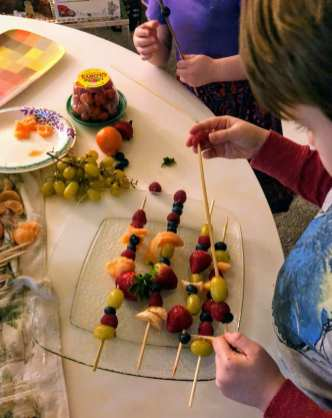 Kids Making Fruit Kabobs 2