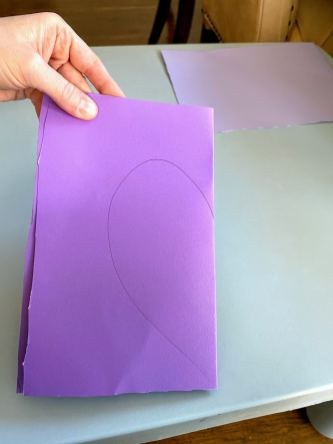folded piece of purple paper