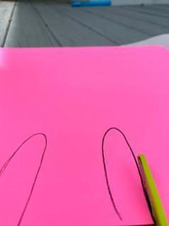 cutting pink ears