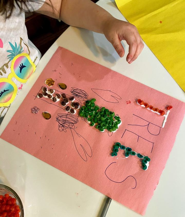 Child's picture of tree with colored shells