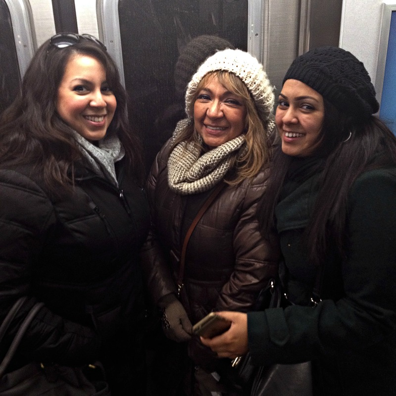 My mother, sister and I traveling on the N train to Queens.