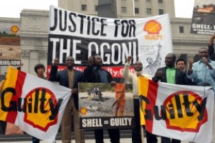 Ogoni supporters sing a solidarity anthem ahead of the human rights case in New York, 27 May 2009
