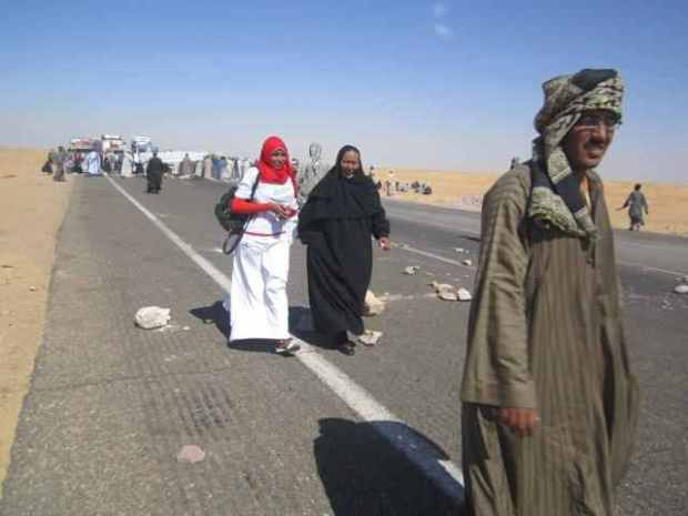 women_walk_down_blocked_road