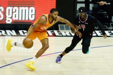 epa09314613 Phoenix Suns forward Mikal Bridges (L) in action against Los Angeles Clippers guard Regie Jackson (R) during the second quarter of game 6 of the NBA playoffs Western Conference final between the Phoenix Suns and the Los Angeles Clippers at the Staples Center in Los Angeles, California, USA, 30 June 2021. EPA/ETIENNE LAURENT SHUTTERSTOCK OUT