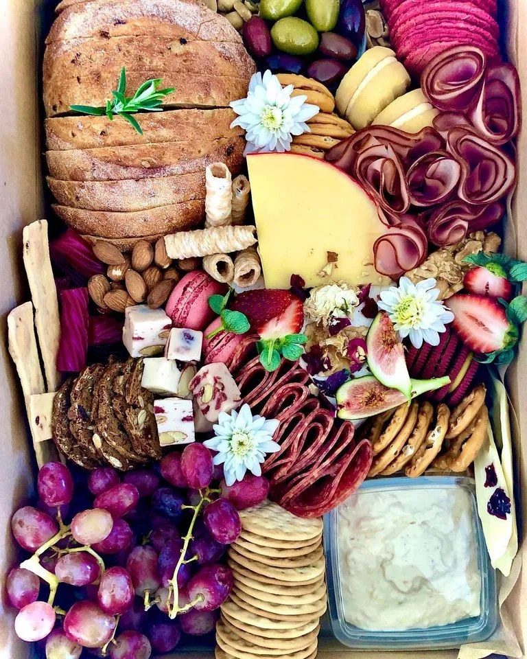 a platter of bread and charcuterie