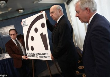Dour man looks sternly at fake clock