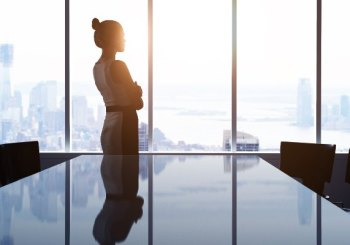 Female executive looking out window
