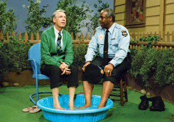 Mister rogers in kiddie pool with a friend.