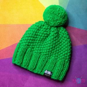 Зелёная вязаная шапка с помпоном Симпл