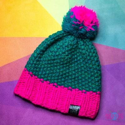 Изумрудно-розовая вязаная шапка с помпоном Квант