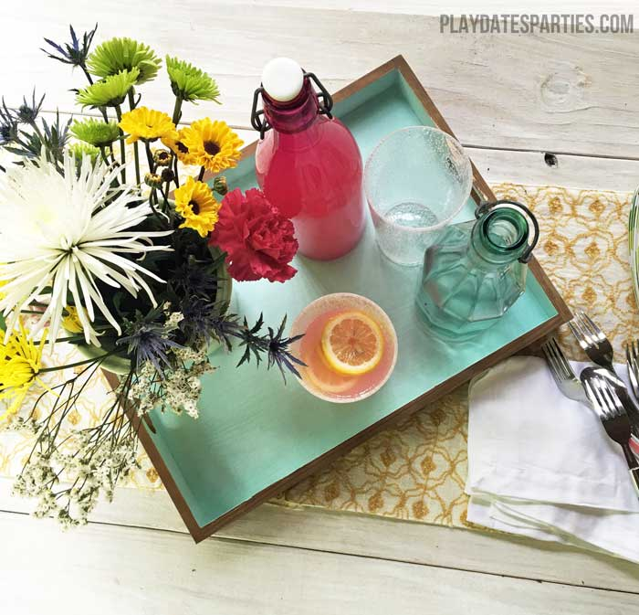 An unfinished tray gets a modern makeover with a natural stain on the outside and blue chalk-style paint on the inside.