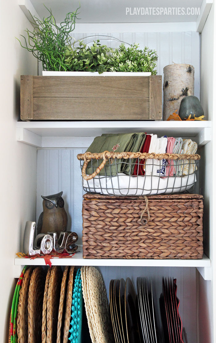 Narrow built-in shelves get a makeover to provide storage that is both functional as well as beautiful.