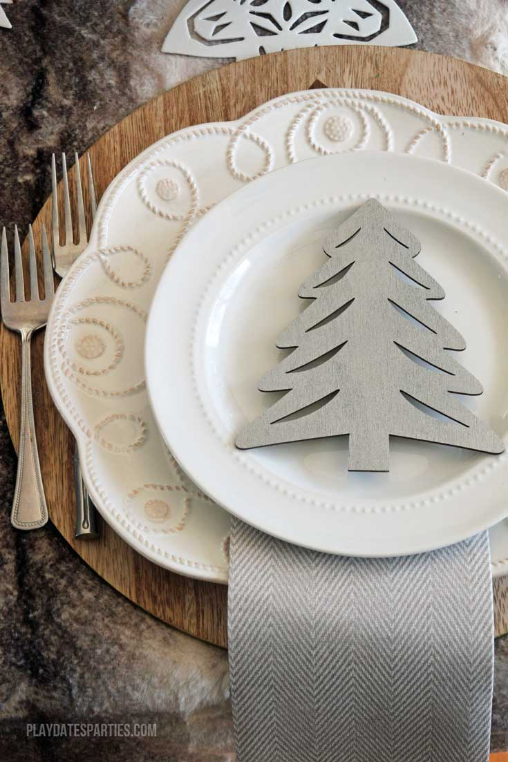 Don't spend a fortune to entertain beautifully! Find out how to make an elegant woodland holiday tablescape you can actually afford to recreate!