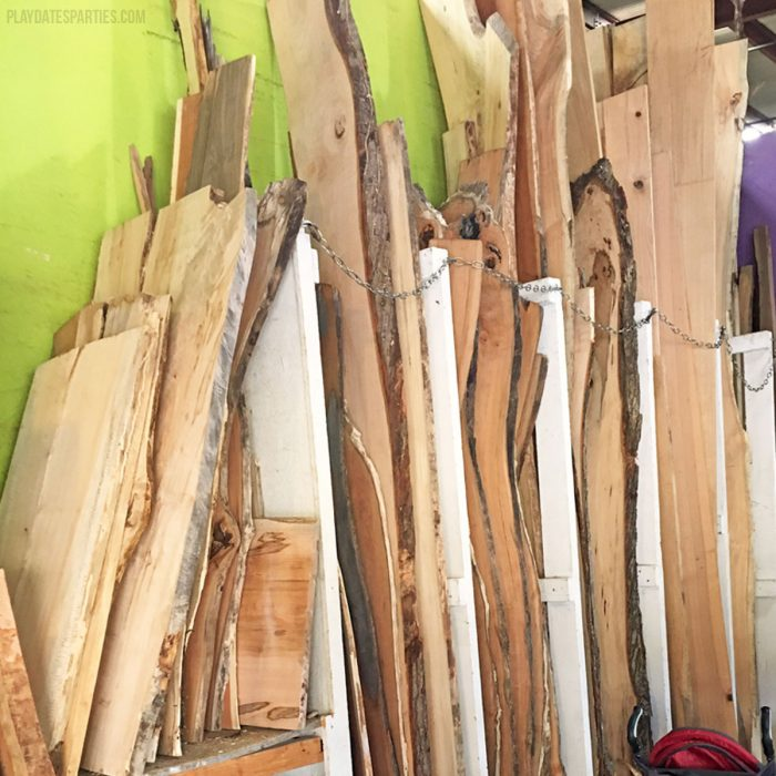 Finding slabs for live edge wood shelves at a local salvage yard.