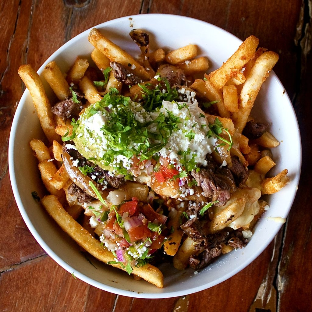 CARNE ASADA FRIES AT PLAYGROUND BAR AND LOUNGE
