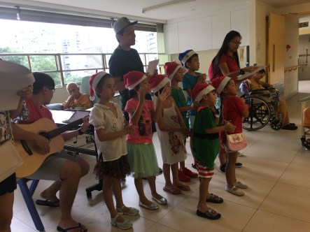 Seven children came down to bring Christmas cheer to elderly at Bright Hill Ever Green Home. They were dressed as little Santas and elves and they sang songs to elderly. The elderly were thrilled to see children. They brought joy.