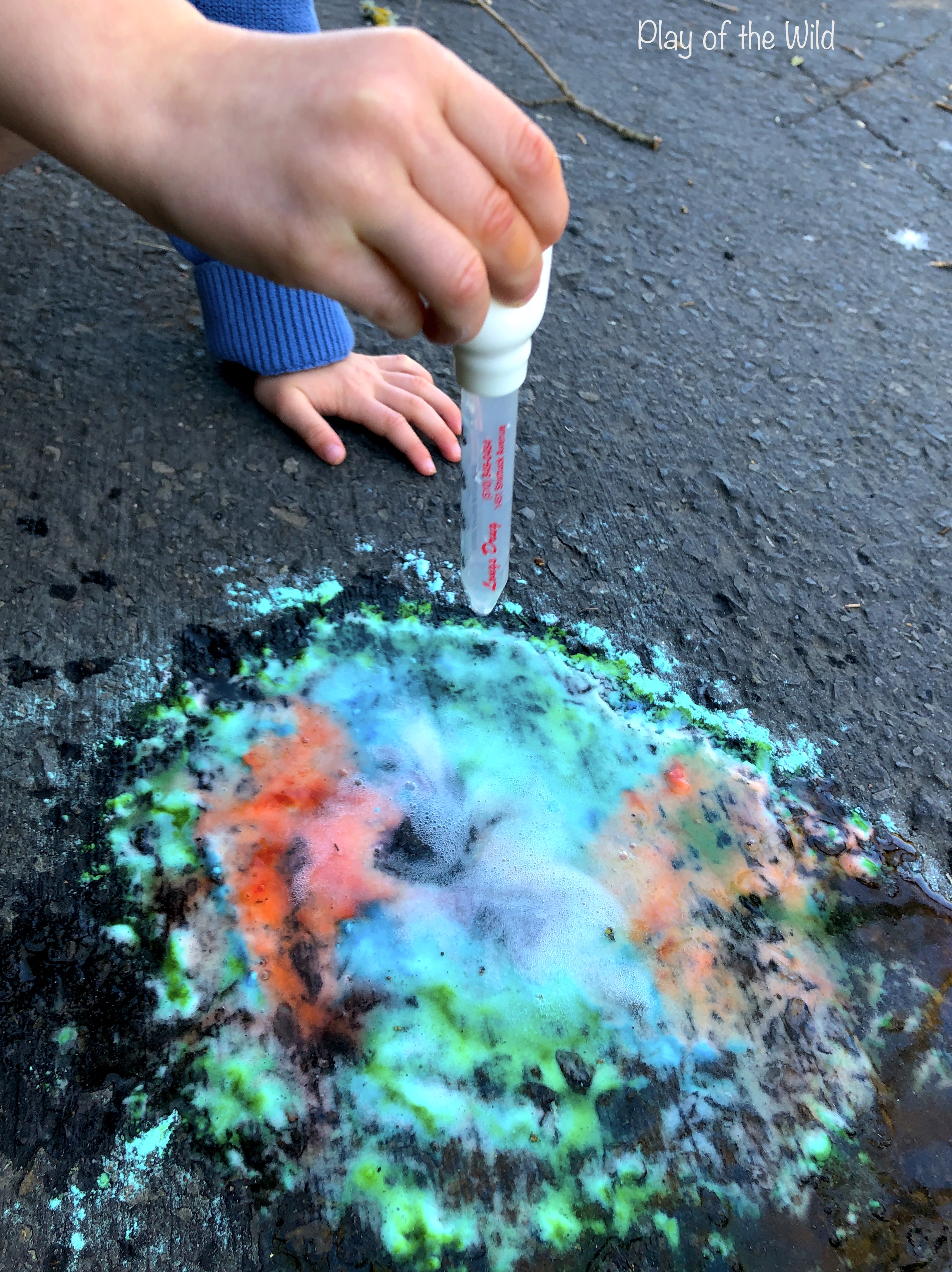 Colorful baking soda and vinegar experiment for kids.