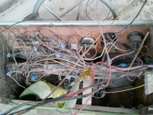 small resolution of that is the back side of the console yikes right most of that rat s nest went toward the rear of the boat i assume to the battery