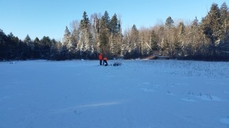 Matt and his brother hacking holes through about 4 or 5 inches of ice.