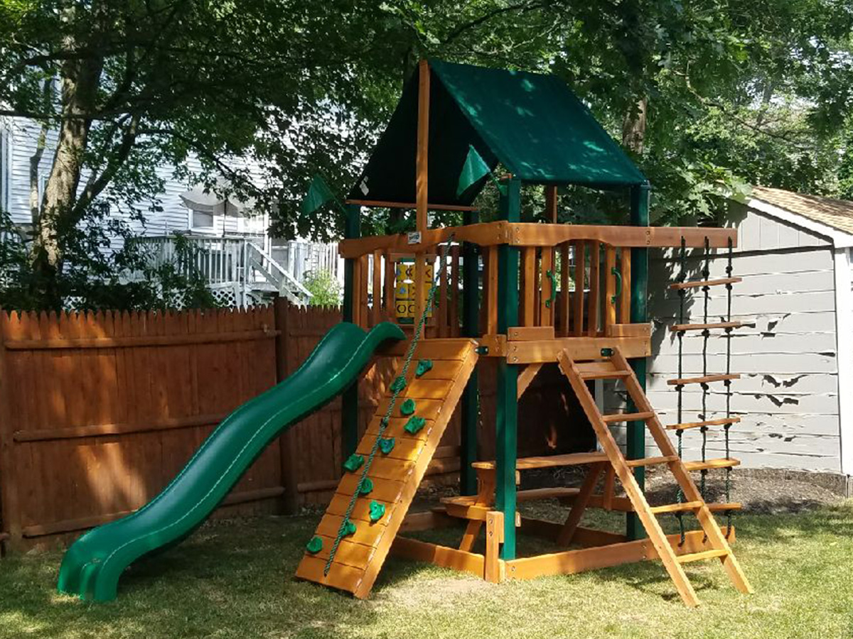 Gorilla Chateau Tower Swing Set Installation in Reading, MA