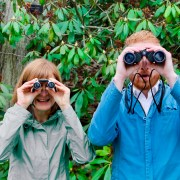 Lisa Tucker and Ed Hoopman looking through binoculars.