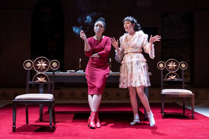 Amber James (Anna) and Sophie Wu (Lyudmila).