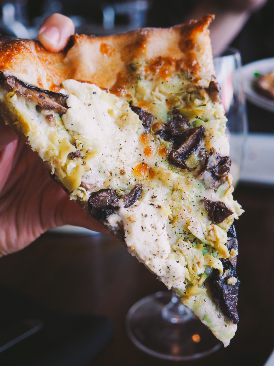 olive oyl pizza (pesto, roasted mushrooms, artichokes, olives, & melty pools of fresh ricotta) at red wagon pizza company in sw minneapolis via playswellwithbutter.com