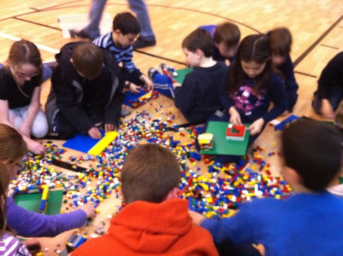 Kids rebuilding their city out of LEGO.