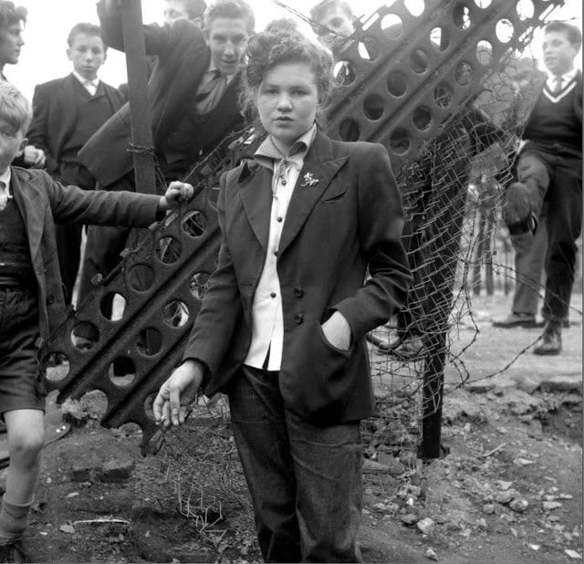 Teddy Girl surrounded by Teddy Boys.